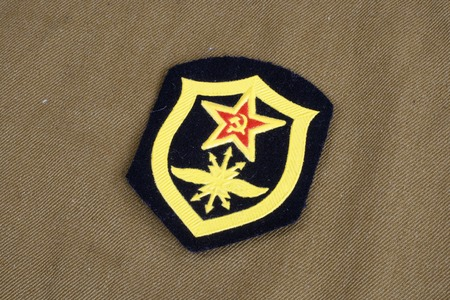 troops: Soviet Army Signal Troops shoulder patch on khaki uniform background