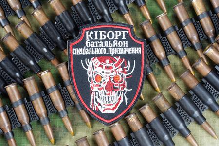 KIEV, UKRAINE - July, 08, 2015. Ukraine Army unofficial uniform badge CYBORG with military ammunition 報道画像