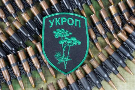 unofficial: KIEV, UKRAINE - July, 08, 2015. Ukraine Army unofficial uniform badge UKROP with military ammunition