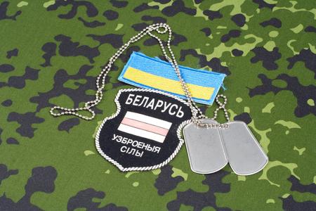 KIEV, UKRAINE - August, 06, 2015. Belarusian volunteers in the Ukraine Army. Russian-Ukraine war 2014 - 2015. Unofficial uniform badge with identification dog-tags 에디토리얼