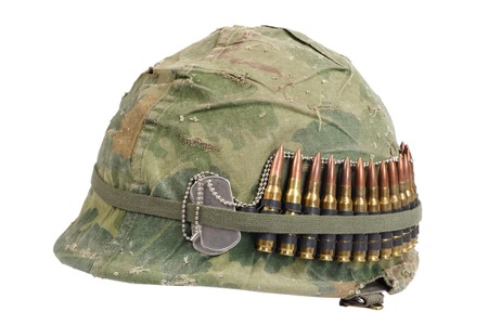 army camo: US Army helmet with camouflage cover and ammo belt and dog tags - Vietnam war period