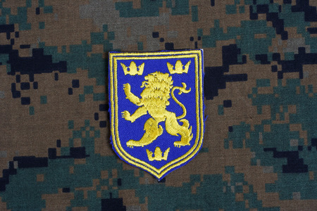 illustrative material: KIEV, UKRAINE - July, 16, 2015.  Ukraine Army uniform badge - coat of arms Editorial