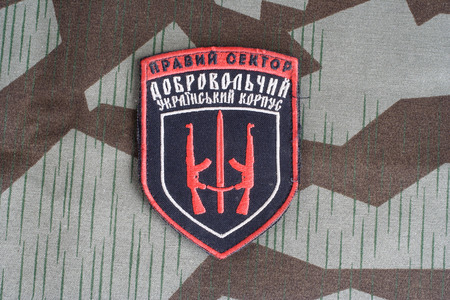 illustrative material: KIEV, UKRAINE - July, 08, 2015. Chevron of Ukrainian volunteers corps with the words Ukrainian Volunteer Corps Right Sector