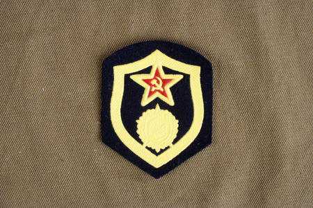 troops: Soviet Army chemical troops shoulder patch on khaki uniform background Stock Photo