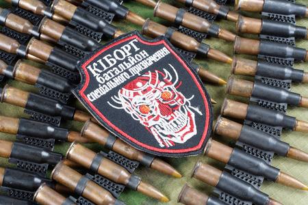 unofficial: KIEV, UKRAINE - July, 08, 2015. Ukraine Army unofficial uniform badge CYBORG  with military ammunition