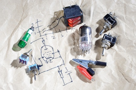 cathode: old vacuum tube with electric scheme background