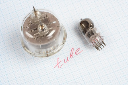 cathode: old vacuum tube (electron tube) on graph paper background