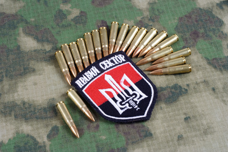 radicals: KIEV, UKRAINE - July, 08, 2015. Chevron of Ukrainian volunteers corps with the words Ukrainian Volunteer Corps Right Sector with military ammunition Editorial