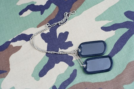 us army woodland  camouflaged uniform with blank dog tags background