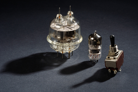 triode: old vacuum tube on black background Stock Photo