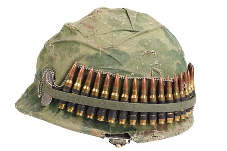ammo: US Army helmet with camouflage cover and ammo belt and dog tags - Vietnam war period