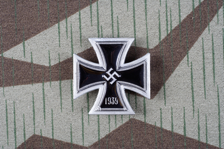 nazi german award Iron Cross on camouflage uniform Stock Photo