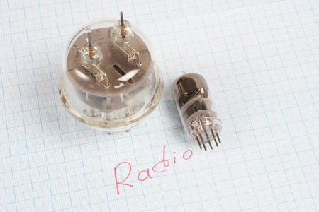 old vacuum tube (electron tube) on graph paper background
