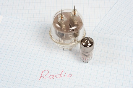 electron: old vacuum tube (electron tube) on graph paper background