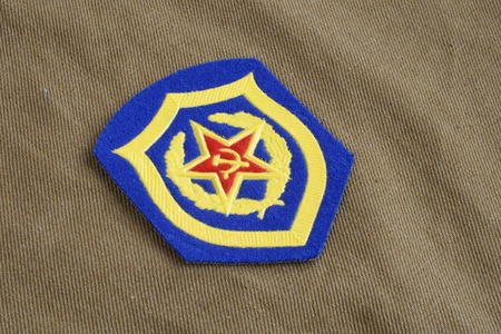 infantry: Soviet Army Mechanized infantry shoulder patch on khaki uniform background Stock Photo