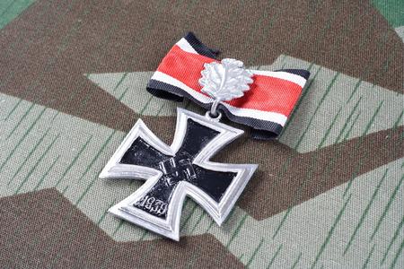 adolf: nazi award - Knights Cross of the Iron Cross on camouflage uniform Editorial