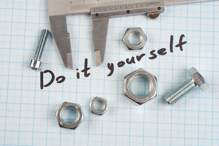 do it yourself: Do it yourself - Screw, Nuts and caliper on  graph paper background