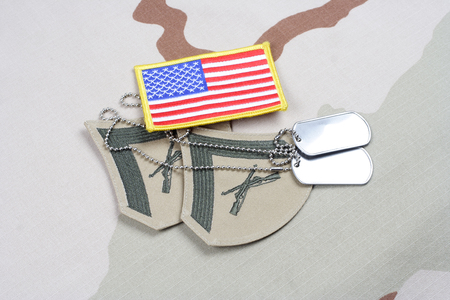 corporal: KIEV, UKRAINE - May 18, 2015. US MARINES Lance Corporal rank patch with US Flag on desert uniform