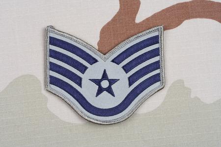 rank: KIEV, UKRAINE - May 18, 2015. US AIR FORCE Staff Sergeant rank patch on desert uniform