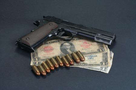 45 ammo:  M1911 on black background Stock Photo