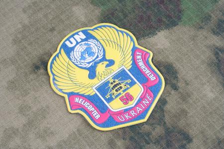 un: KIEV, UKRAINE - Apr. 26, 2015. Ukraine Army UN uniform badge