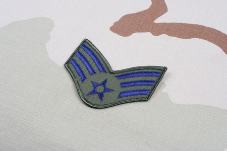 us air force: KIEV, UKRAINE - May 18, 2015. US AIR FORCE Senior Airman rank patch on desert uniform