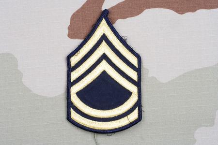 rank: KIEV, UKRAINE - May 18, 2015. US ARMY Sergeant First Class rank patch on desert uniform Editorial