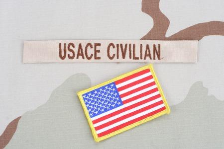 animal private: KIEV, UKRAINE - June 14, 2015. USACE CIVILAN branch tape with flag patch on desert camouflage uniform