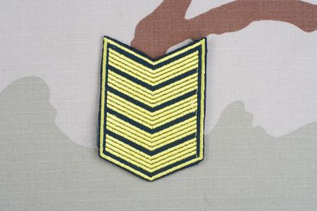 sergeant: KIEV, UKRAINE - May 18, 2015. ARMY Sergeant rank patch on desert uniform Editorial