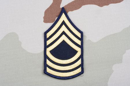 rank: KIEV, UKRAINE - May 18, 2015. US ARMY Master Sergeant rank patch on desert uniform