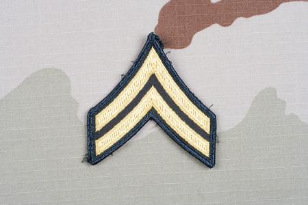 corporal: KIEV, UKRAINE - May 18, 2015. US ARMY Corporal rank patch on desert uniform Editorial