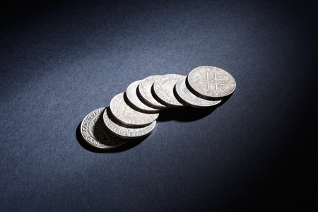 black textured background: Old silver coins on a black textured background Stock Photo