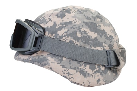 kevlar: kevlar helmet with a camouflage cover and protective goggles isolated on white background