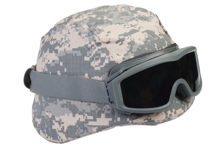 helmet with a camouflage cover and protective goggles isolated on white background Imagens
