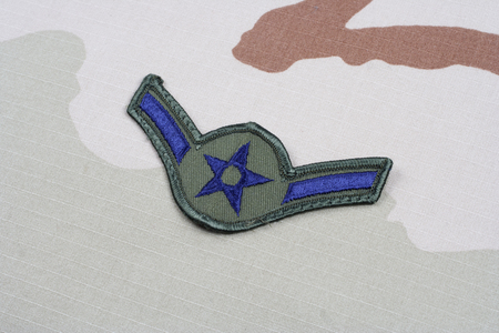 us air force: KIEV, UKRAINE - May 18, 2015. US AIR FORCE Airman rank patch on desert uniform