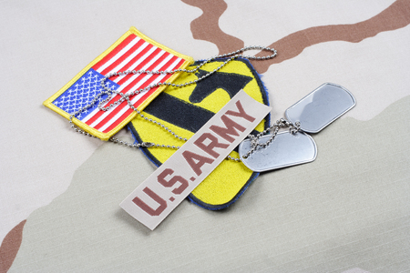cavalry: KIEV, UKRAINE - May 18, 2015. US ARMY 1st Cavalry Division patch whith dog tags on desert uniform Editorial