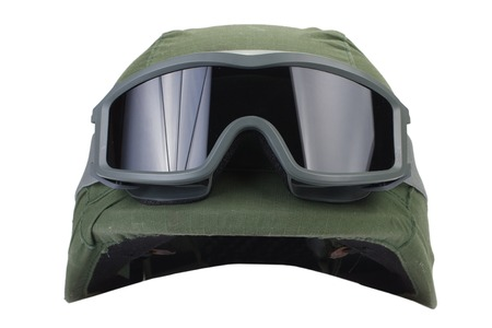 protective goggles: helmet with a camouflage cover and protective goggles isolated on white background