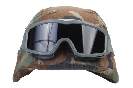 protective goggles: kevlar helmet with a camouflage cover and protective goggles isolated on white background
