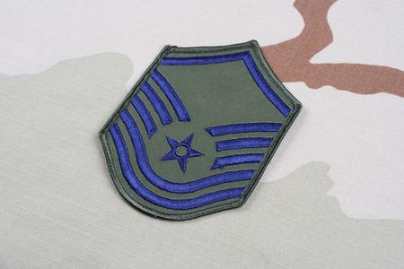 us air force: KIEV, UKRAINE - May 18, 2015. US AIR FORCE Master Sergeant rank patch on desert uniform