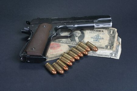 45 ammo: M1911 on black background