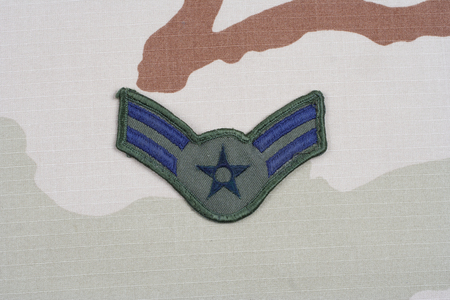 us air force: KIEV, UKRAINE - May 18, 2015. US AIR FORCE Airman First Class rank patch on desert uniform