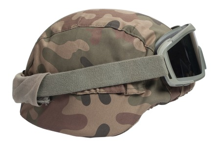 protective goggles: Helmet with camouflage cover and protective goggles Stock Photo