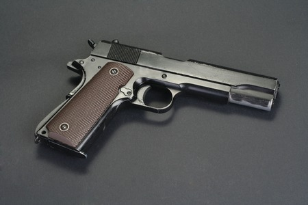 45 gun: colt goverment M1911 on black background