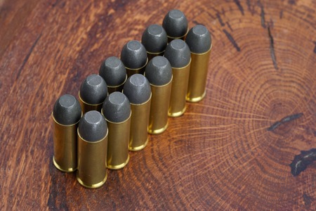 45 ammo: The .45 Revolver cartridges Wild West period on wooden background