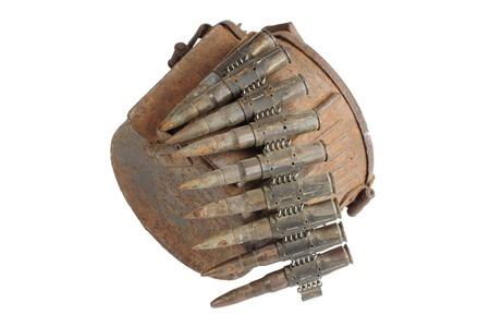 machine gun: old rusty machine gun ammunition case isolated