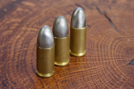 9mm ammo: The 9mm caliber cartridge on wooden background
