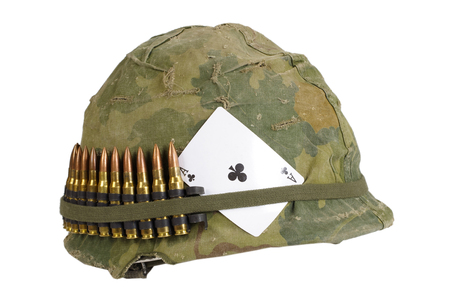 US Army helmet Vietnam war period with camouflage cover and ammo belt and amulet - ace of clubs playing card