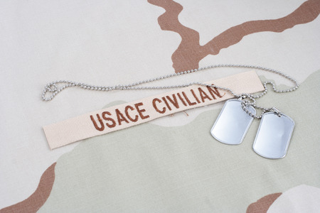 KIEV, UKRAINE - June 14, 2015. USACE CIVILAN branch tape with dog tags on desert camouflage uniform Editorial