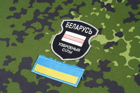 unofficial: KIEV, UKRAINE - August, 06, 2015. Belarusian volunteers in Ukraine  Army. Russian-Ukraine war 2014 - 2015. Unofficial uniform badge with identification dog-tags Editorial