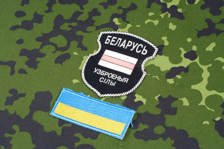 KIEV, UKRAINE - August, 06, 2015. Belarusian volunteers in Ukraine  Army. Russian-Ukraine war 2014 - 2015. Unofficial uniform badge with identification dog-tags Editorial